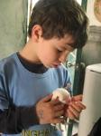 Daniel nursing the pup!