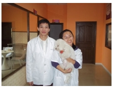 Our Vet Dr. Wu and Nurse Wu with Coco (Dr. Wu's dog)